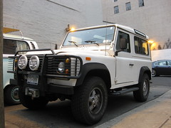 automobile(1.0), automotive exterior(1.0), sport utility vehicle(1.0), vehicle(1.0), compact sport utility vehicle(1.0), off-roading(1.0), land rover defender(1.0), off-road vehicle(1.0), bumper(1.0), land vehicle(1.0),