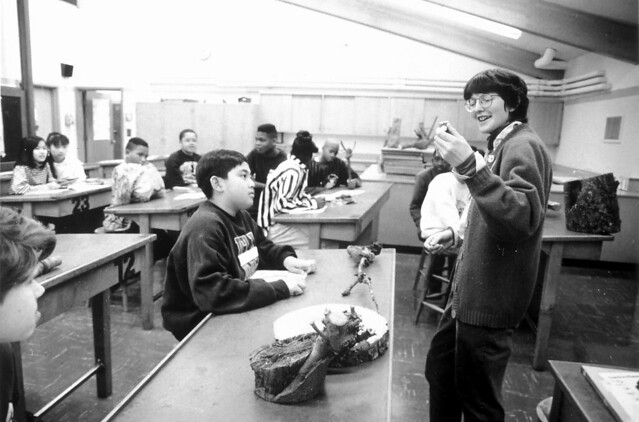 Teacher and students in classroom, circa 1990s from Flickr via Wylio