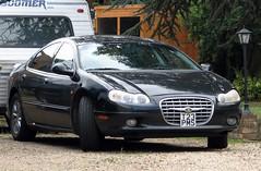convertible(0.0), automobile(1.0), automotive exterior(1.0), executive car(1.0), family car(1.0), vehicle(1.0), automotive design(1.0), chrysler(1.0), sedan(1.0), land vehicle(1.0), luxury vehicle(1.0),