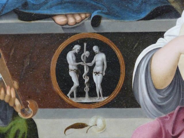"""Détail, Francesco Marmitta. """"La Vierge et l'Enfant entourés de saint Benoît et de saint Quentin, et de deux anges"""", circa 1500-1505. Musée du Louvre, Paris, 18 octobre 2009."""
