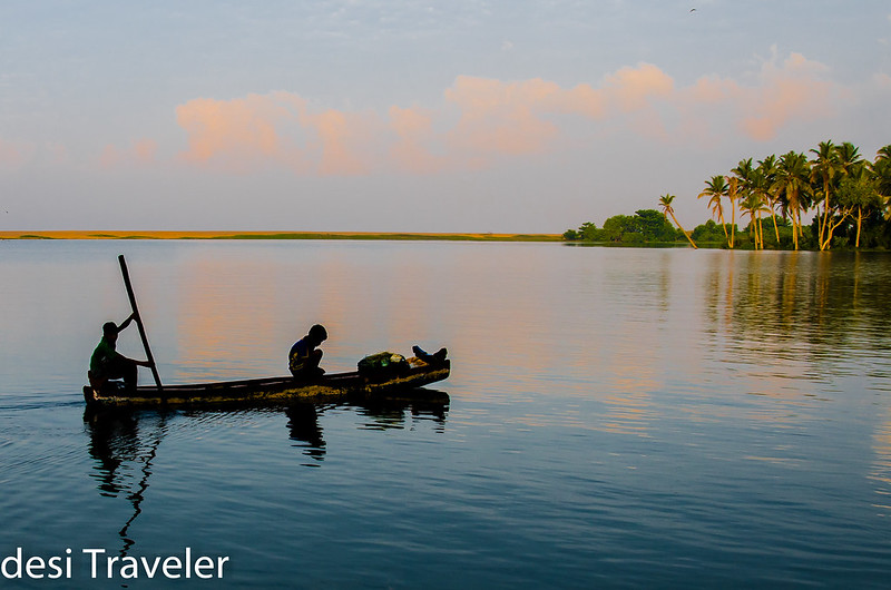 fishermen in canoe in backwaters in Kerala