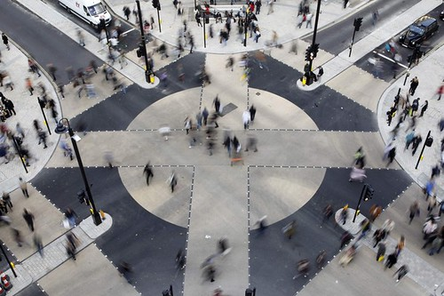 Pedestrian cross the new diagonal crossing at Oxford Circus in London