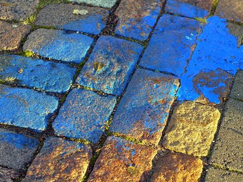 blue paint pavement cobbles kotka sapokka panasoniclumixg1 topcorregn50mmf18