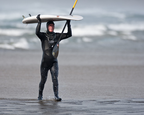 Russ Garing, SUP Standup Paddle Boarder.  Surfing at Morro Rock in Big Winter Waves, Morro Bay, CA 11 Dec 2009.