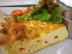 vegetarian food(0.0), produce(0.0), dessert(0.0), meal(1.0), breakfast(1.0), baked goods(1.0), food(1.0), dish(1.0), cuisine(1.0), quiche(1.0), tortilla de patatas(1.0), omelette(1.0),