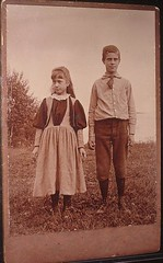 Country boy and girl in Feild Antique cabinet photo from victorian age