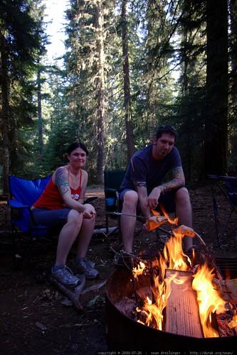 rachel and jeff roasting salmon on an open fire    MG 9607
