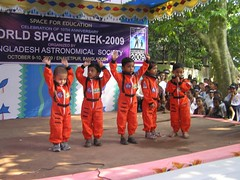 Kid Astronauts are waving  hands expressing their willingness to go to Space.