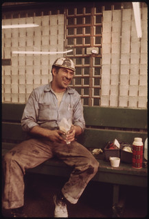 Miner Spreads His Lunch Out on a Bench in the Shower and Time Card Room of the Virginia-Pocahontas Coal Company Mine #3 near Richlands, Virginia. He Hauls Equipments Into the Mine During His Work Shift 04/1974
