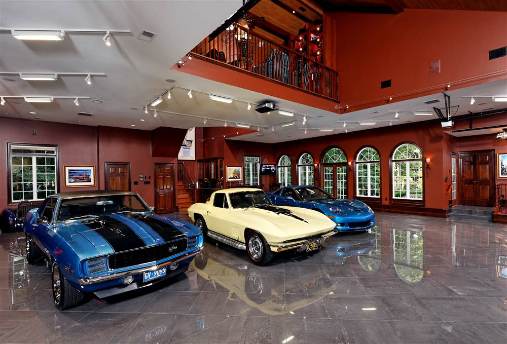 World 39 s most beautiful garages exotics insane garage for Cool car garage ideas