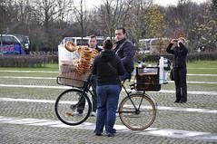 Man Selling Pretzels on Bike