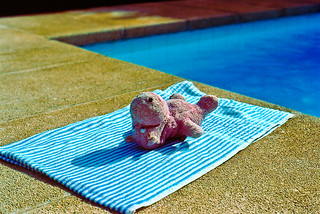 Naked hippo toy sunbathing by pool ?! , Majorca