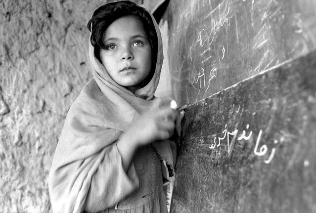Young Afghan Girl Attends School