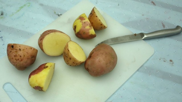 Cut the potatoes in half