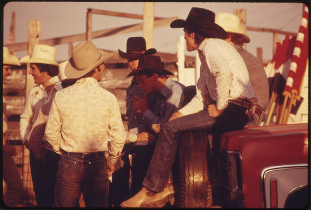 Group of Cowboys Gathered Around the Chutes at the Annual Flint Hills Rodeo, a Major Cultural Event of the Area at Cottonwood Falls, Kansas, near Emporia...06/1974 from Flickr via Wylio