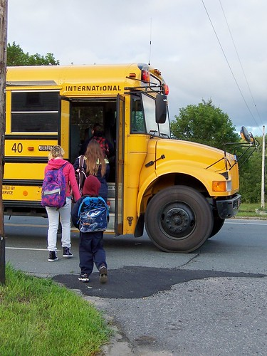 Getting on the bus for the first ride in the first grade school season.