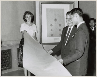 Photograph of King of Thailand Viewing Facsimiles of Early Siamese Treaty with Pat Steffing and Third Archivist of the United States Dr. Grover, 1960