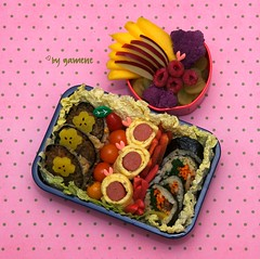 Fancy garnish in a Bento box
