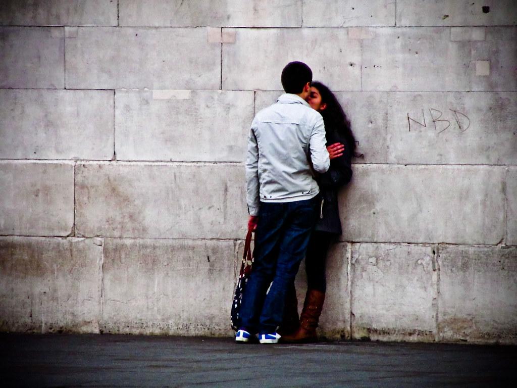 Smooching by a Wall