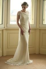 sleeve(0.0), cocktail dress(0.0), bridesmaid(0.0), bride(1.0), bridal party dress(1.0), bridal clothing(1.0), neck(1.0), textile(1.0), gown(1.0), clothing(1.0), woman(1.0), satin(1.0), formal wear(1.0), wedding dress(1.0), dress(1.0),