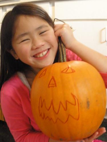Sophia with Pumpkin She Drew