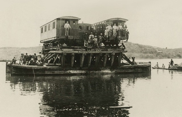 A heavy ferry with three wagons on the upper deck in Indochina (Vietnam) - 1930