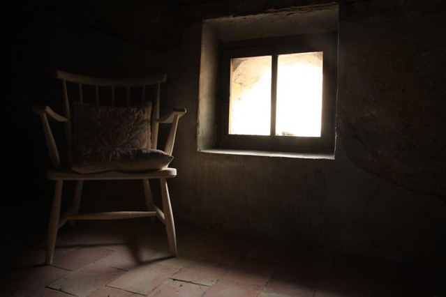 Old chair next to a window on an attic flickr photo for Chair next to window