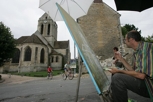 Artists in Auvers-sur-Oise do their best to capture the church made famous by Van Gogh. Photo: Pierre Marcel