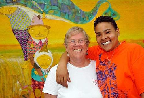 Sally Levin and her daughter Leah in front of a wall painted by Os Gemeos, twin street/graffiti artists from Sao Paulo, Brazil, in New York City, summer 2009.  Photo by Marty Cooper.