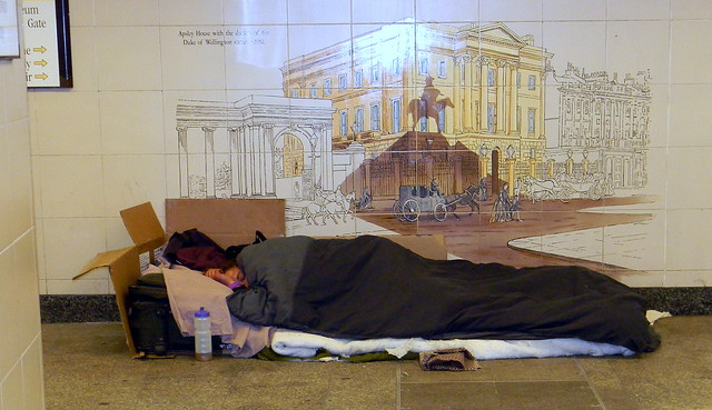 Homeless man sleeping subway Hyde park tube station London 28th May 2011 17:31.52pm