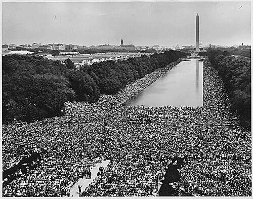 Civil Rights March on Washington, D.C. [A wide-angle view of marchers along the mall, showing the Reflecting Pool and the Washington Monument.], 08/28/1963