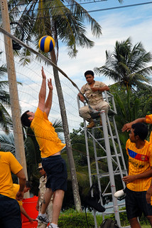 SIHANOUKVILLE, Cambodia (June 15, 2011) A Sailor from USS Avenger (MCM 1) jumps to block a shot during a volleyball game with members of the Royal Cambodian Armed Forces. (Official U.S. Navy photo)