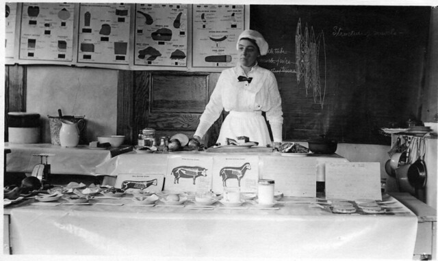 Extension school on meats held at Cherry Valley, NY, in 1915. The instructor is ...