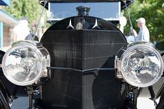 window(0.0), wheel(0.0), motorcycle(0.0), automobile(1.0), automotive exterior(1.0), vehicle(1.0), automotive design(1.0), light(1.0), glass(1.0), headlamp(1.0), vintage car(1.0), land vehicle(1.0), windshield(1.0),