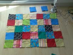 quilt(0.0), linens(0.0), quilting(0.0), bed sheet(0.0), art(1.0), textile(1.0), patchwork(1.0), flooring(1.0),
