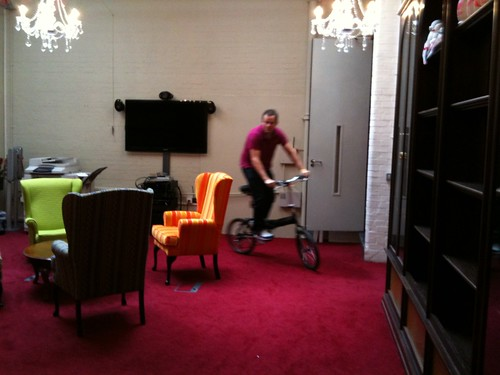 Colman cycling round the office