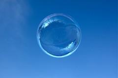 reflection(0.0), earth(0.0), liquid bubble(1.0), drop(1.0), water(1.0), sphere(1.0), light(1.0), macro photography(1.0), azure(1.0), circle(1.0), blue(1.0), sky(1.0),