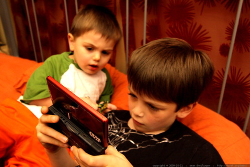 sequoia watches nick playing lego batman on the nintendo DS