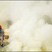 working man and smoke - Kawah Ijen by Maciej Dakowicz