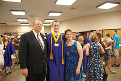 Andrew with mom and dad at graduation