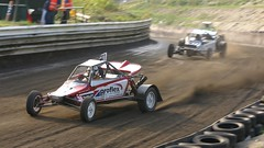 auto racing(1.0), automobile(1.0), racing(1.0), vehicle(1.0), sports(1.0), race(1.0), dirt track racing(1.0), off road racing(1.0), motorsport(1.0), off-roading(1.0), sprint car racing(1.0), race track(1.0),