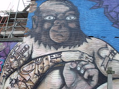 Pro graffiti of a ape man in Deritend, Digbeth - News and Agent