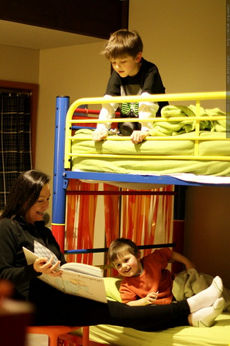 bedtime story: nick reads from the top bunk   grandma is just the page turner