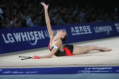 balance beam(0.0), sports(0.0), swimmer(0.0), uneven bars(0.0), floor gymnastics(1.0), individual sports(1.0), gymnastics(1.0), gymnast(1.0), artistic gymnastics(1.0), athlete(1.0),
