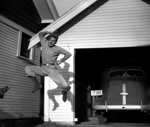 1947 -- My Uncle Gil Jumping Before my Grandmother's Garage.