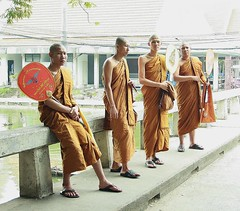 monks on a bridge