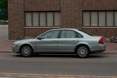 automobile(1.0), automotive exterior(1.0), family car(1.0), wheel(1.0), vehicle(1.0), full-size car(1.0), mid-size car(1.0), volvo s80(1.0), bumper(1.0), sedan(1.0), land vehicle(1.0), luxury vehicle(1.0),