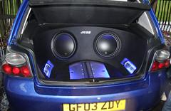 wheel(0.0), rim(0.0), steering wheel(0.0), sedan(0.0), vehicle audio(1.0), automobile(1.0), automotive exterior(1.0), vehicle(1.0), bumper(1.0),