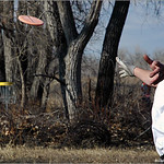 Eric Basey threads his shot through the trees at mini Ice Bowl in Fort Morgan.