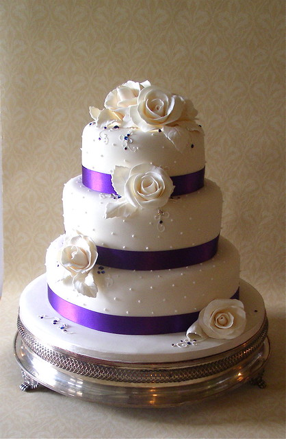 Ivory purple rose wedding cake